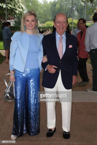 Hilary Geary Ross and Wilbur Ross attend the 12th Annual Get Wild Summer Benefit on June 23 2018 in Southampton New York