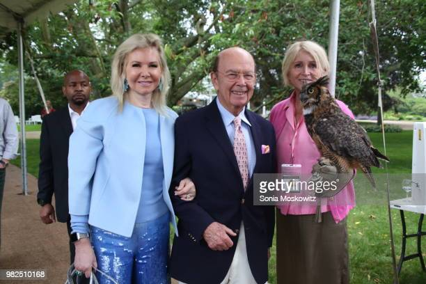 Hilary Geary Ross Wilbur Ross and Jane Gill attend the 12th Annual Get Wild Summer Benefit on June 23 2018 in Southampton New York