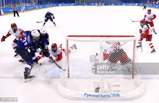 Hilary Knight and Kendall Coyne of the United States battle for the puck against Olympic Athletes from Russia during the Women's Ice Hockey...