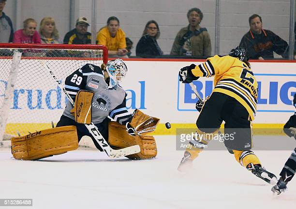 Hilary Knight of the Boston Pride scores a goal against Brianna McLaughlin of the Buffalo Beauts during Game 2 of the league's inaugural championship...