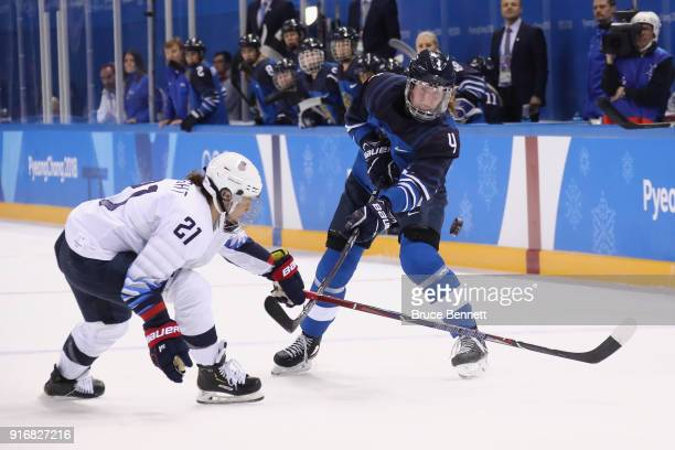 Hilary Knight of the United States and Rosa Lindstedt of Finland battle for the puck in the first period during the Women's Ice Hockey Preliminary...