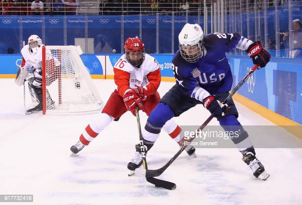 Hilary Knight of the United States and Yekaterina Nikolayeva of Olympic Athlete from Russia battle for the puck in the first period during the...