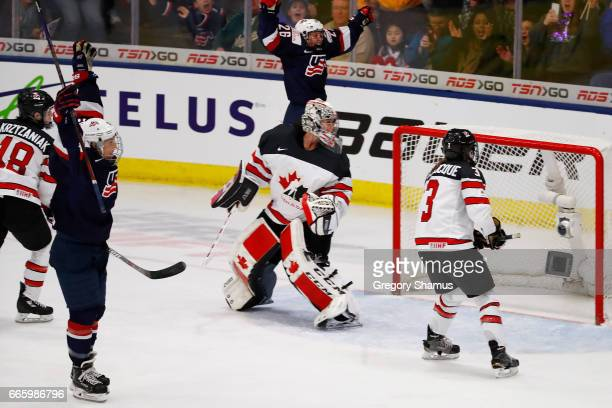 Hilary Knight of the United States celebrates her game winning overtime goal in front of Shannon Szabados of Canada in the gold medal game at the...