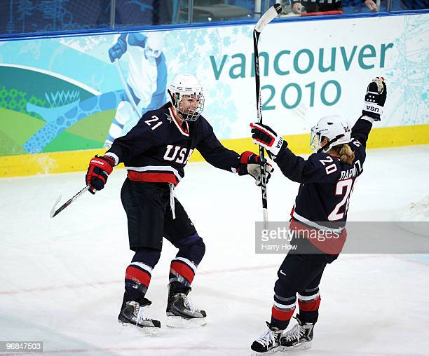Hilary Knight of the United States celebrates her goal with teammate Natalie Darwitz to make it 50 during the ice hockey women's preliminary game...