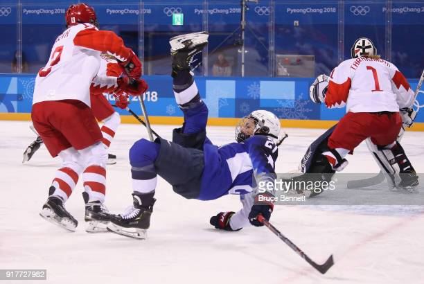 Hilary Knight of the United States falls on the ice in the first period against Olympic Athletes from Russia during the Women's Ice Hockey...
