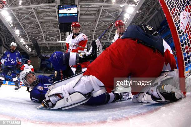 Hilary Knight of the United States gets tangled up with Nadezhda Morozova of Olympic Athlete from Russia in the third period during the Women's Ice...