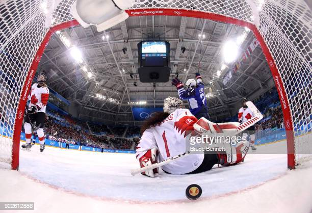 Hilary Knight of the United States scores a power play goal against Shannon Szabados of Canada in the first period during the Women's Gold Medal Game...