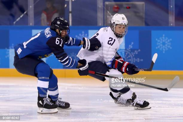 Hilary Knight of the United States skates against Tanja Niskanen of Finland in the first period during the Women's Ice Hockey Preliminary Round Group...