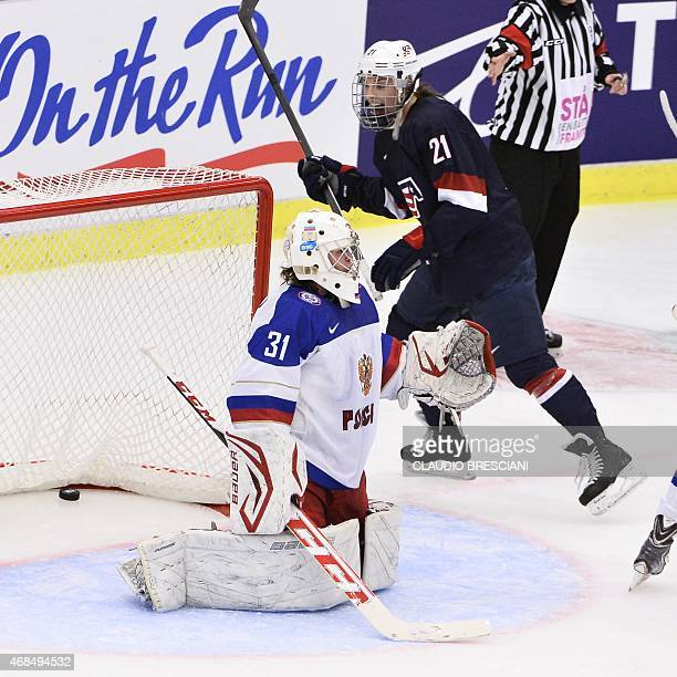 US Hilary Knight reacts after Monique Lamoureux's 31 goal behind Russia's goal keeper Yulia Leskina during the 2015 IIHF Ice Hockey Women's World...
