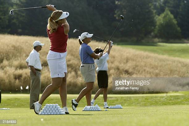 Hilary Lunke Angela Stanford and Kelly Robbins warm up on the driving range in preparation for the 18 hole playoff during the US Women's Open on July...