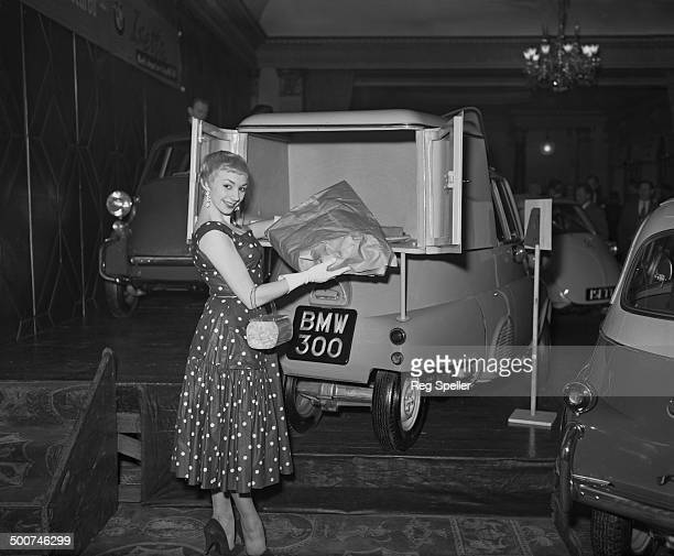 Hilary Martin with a new Britishmade version of a BMW Isetta pickup truck on show at The Dorchester hotel London 2nd April 1957 The vehicle is a...