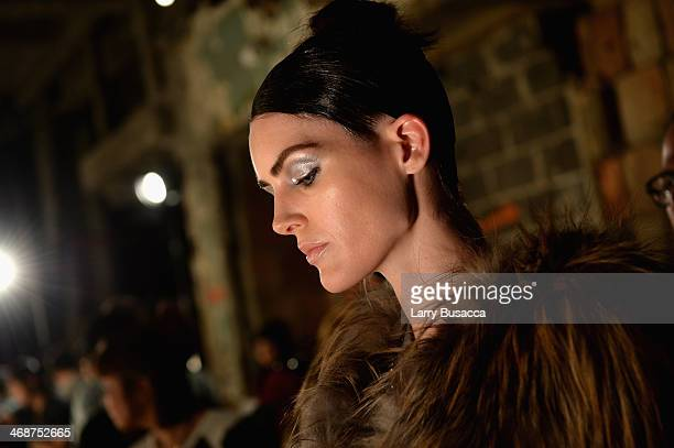 Hilary Rhoda prepares backstage at the Donna Karan New York 30th Anniversary fashion show during MercedesBenz Fashion Week Fall 2014 on February 10...