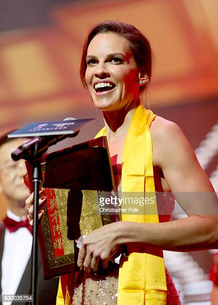 Hilary Swank accepts the Huading Global Critics Award onstage during the 21st Annual Huading Global Film Awards at The Theatre at Ace Hotel on...