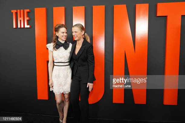 Hilary Swank and Betty Gilpin attend the premiere of Universal Pictures' The Hunt at ArcLight Hollywood on March 09 2020 in Hollywood California