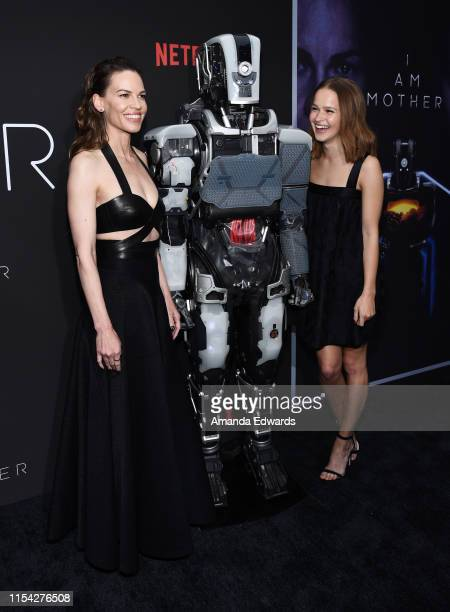 Hilary Swank and Clara Rugaard arrive at the LA Special Screening of Netflix's I Am Mother at ArcLight Hollywood on June 06 2019 in Hollywood...