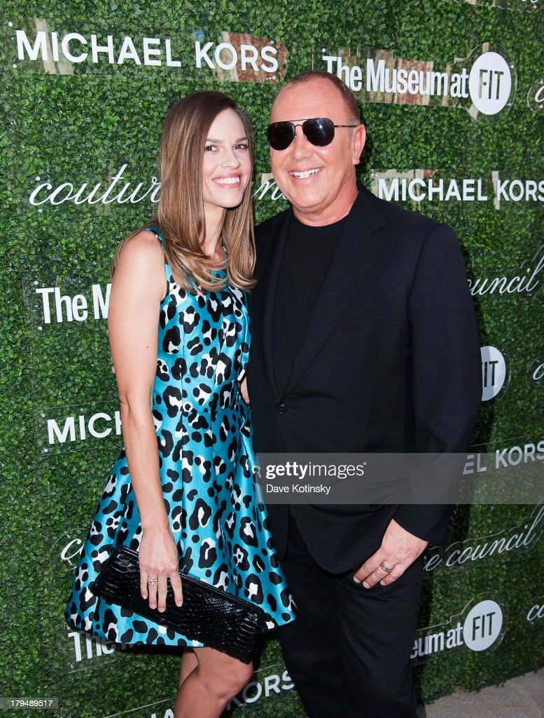 Hilary Swank (L) and designer Michael Kors attend the 2013 Couture Council Fashion Visionary Awards at David H. Koch Theater, Lincoln Center on September 4, 2013 in New York City.