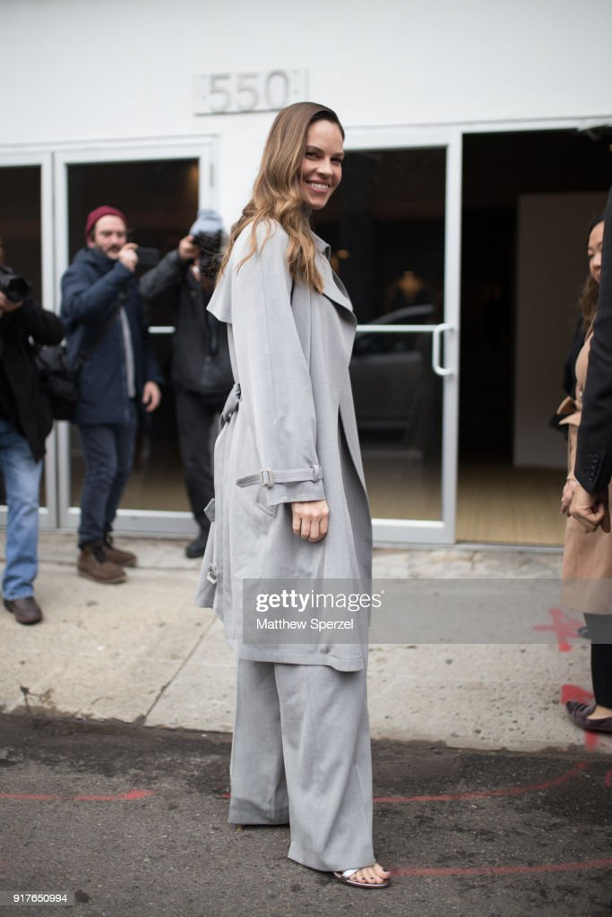 Hilary Swank is seen on the street attending Ralph Lauren during New York Fashion Week wearing a long grey coat on February 12, 2018 in New York City.