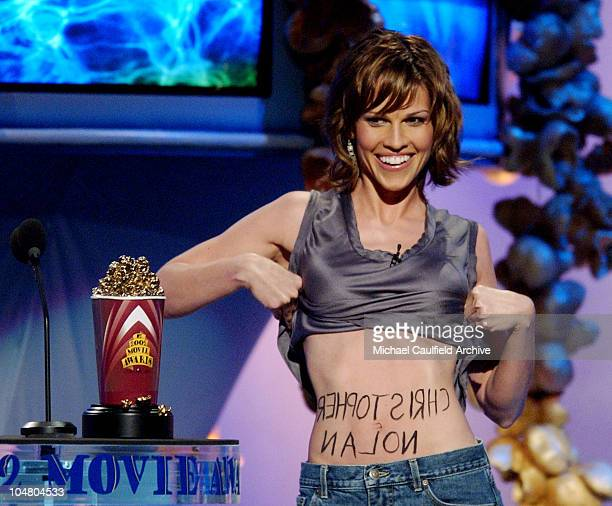 Hilary Swank lifts her shirt to reveal the name of Christopher Nolan winner of the award for Best New Filmmaker at the 2002 MTV Movie Awards in Los...