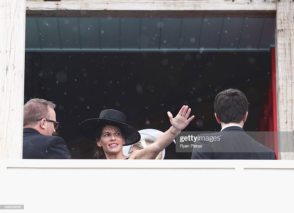 Hilary Swank looks on in the rain at the Swisse Marquee on Derby Day at Flemington Racecourse on October 31, 2015 in Melbourne, Australia.
