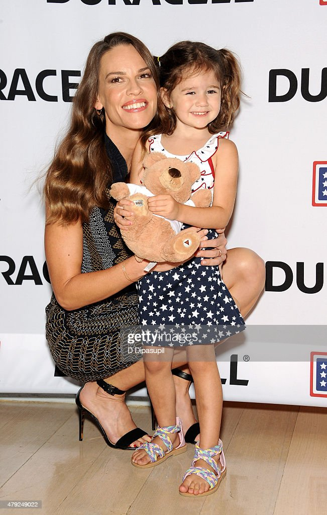 Hilary Swank (L) poses with Mackenzie Nilson at the USO's 'Comfort Crew for Military Kids' program screening at The Times Center on July 2, 2015 in New York City.