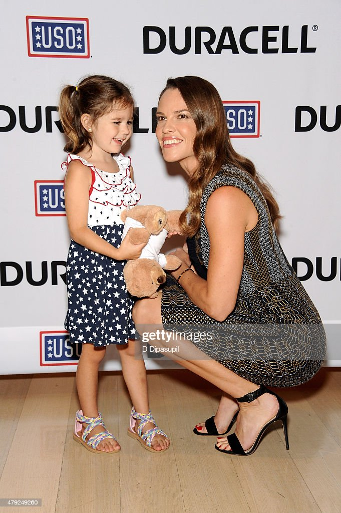 Hilary Swank (R) poses with Mackenzie Nilson at the USO's 'Comfort Crew for Military Kids' program screening at The Times Center on July 2, 2015 in New York City.