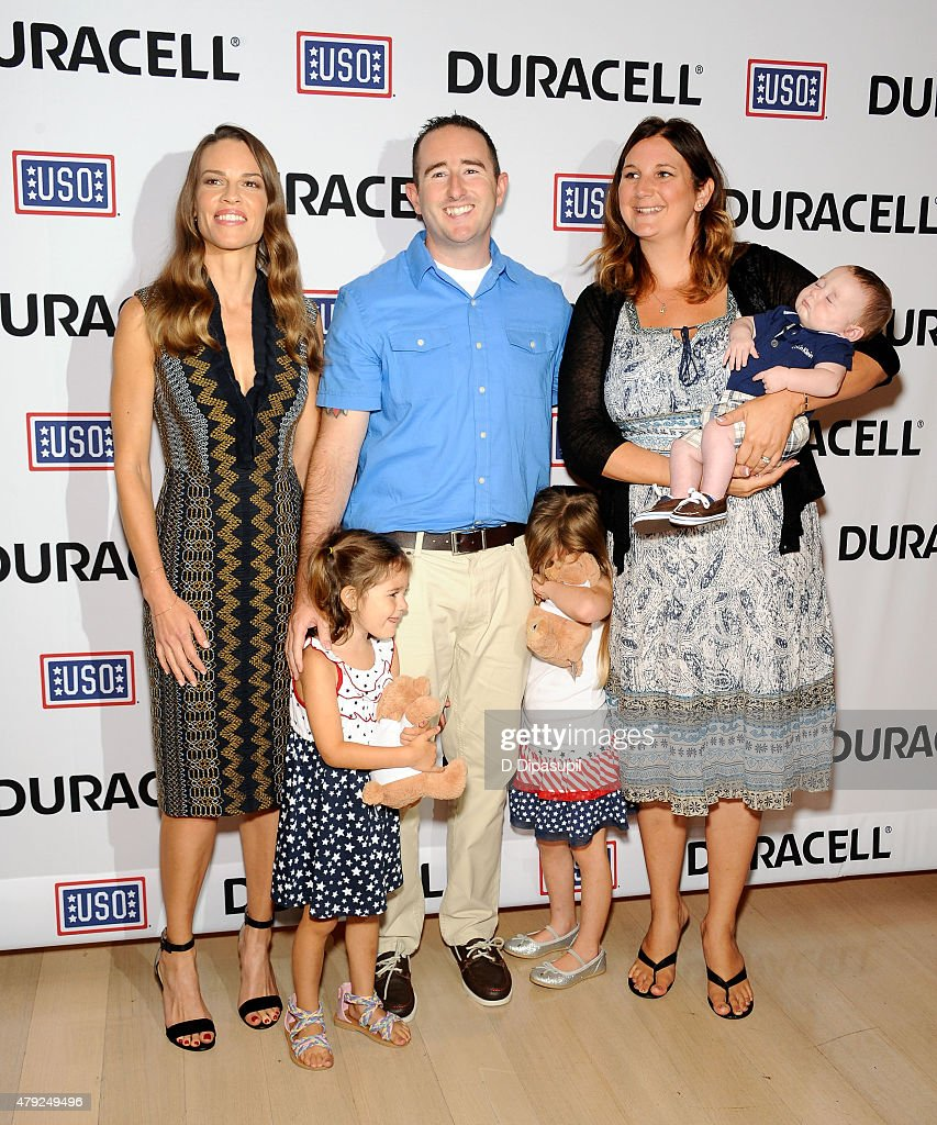 Hilary Swank poses with Mackenzie Nilson, Robert Nilson, Hailey Nilson, Denise Nilson, and Xander Nilson at the USO's 'Comfort Crew for Military Kids' program screening at The Times Center on July 2, 2015 in New York City.