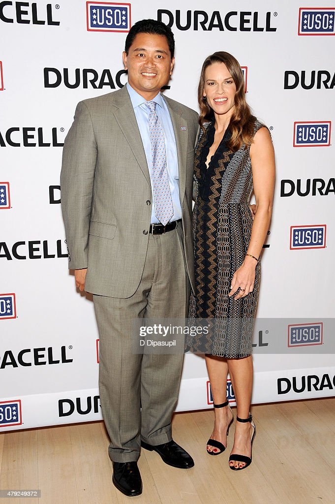 Hilary Swank (R) poses with USO SVP of Operations Alan Reyes at the USO's 'Comfort Crew for Military Kids' program screening at The Times Center on July 2, 2015 in New York City.