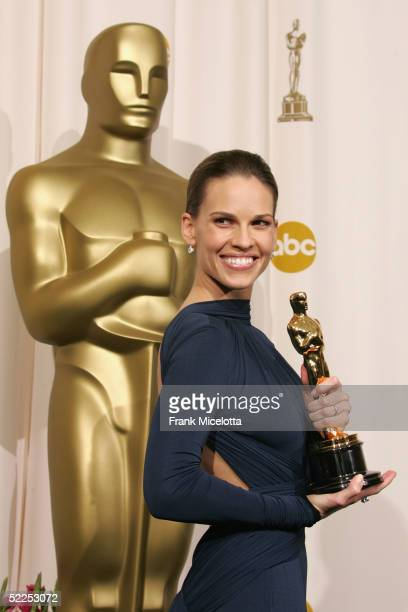 TELECAST*** Hilary Swank smiles with her Oscar for a photo backstage during the 77th Annual Academy Awards on February 27 2005 at the Kodak Theater...