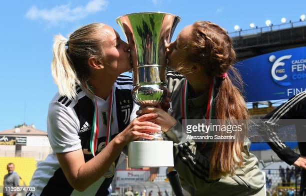 Hilda Petronella Ekroth and Ashley Lynn Nick of Juventus Woman celebrate the victory with the trophy after the Women Coppa Italia Final match between...