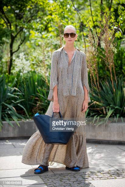 Hilda Sandström is seen wearing dress, navy bag outside Mykke Hofmann during Copenhagen Fashion Week Spring/Summer 2020 on August 06, 2019 in...