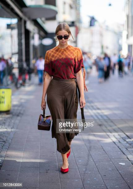 Hilda Sandstroem wearing pointed Balenciaga heels Gestuz skirt Rejina Pyo bag is seen outside Blanche during the Copenhagen Fashion Week...