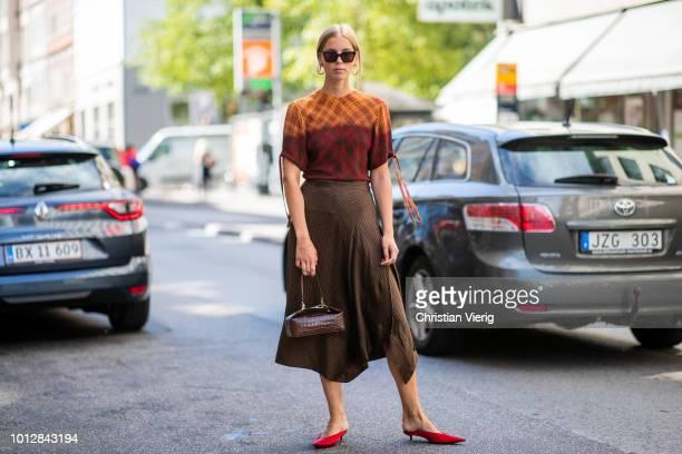 Hilda Sandstroem wearing pointed Balenciaga heels, Gestuz skirt, Rejina Pyo bag is seen outside Mykke Hofmann during the Copenhagen Fashion Week...