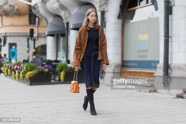 Hilda Sandstroem wearing sock boots brown jacket brown bag navy dress outside Ida Sjoestedt on August 31 2017 in Stockholm Sweden