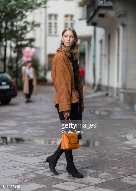 Hilda Sandstroem wearing sock boots brown jacket brown bag navy dress outside Ida Sjoestedt on August 31 2017 in Stockholm Sweden