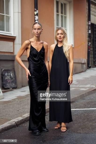 Hilda Sandstrom wearing a black dress and Mikaela Hallen wearing a black dress outside StyleIn during Stockholm fashion week Spring/Summer 2022 on...