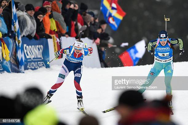 Hilde Fenne of Norway takes 3rd place Yulia Dzhima of Ukraine competes during the IBU Biathlon World Cup Women's Relay on January 12 2017 in...