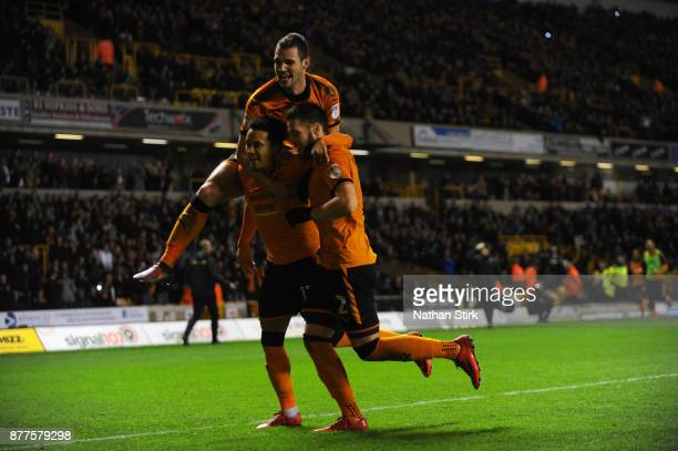 Hilder Costa of Wolverhampton Wanderers celebrates with Matt Doherty and Lo Bonatini after scoring a penalty during the Sky Bet Championship match...