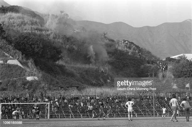 A hill fire rages next to the Police Ground Stadium where a Senior Shield game of USD against Caroline Hill is being held The match was played as...