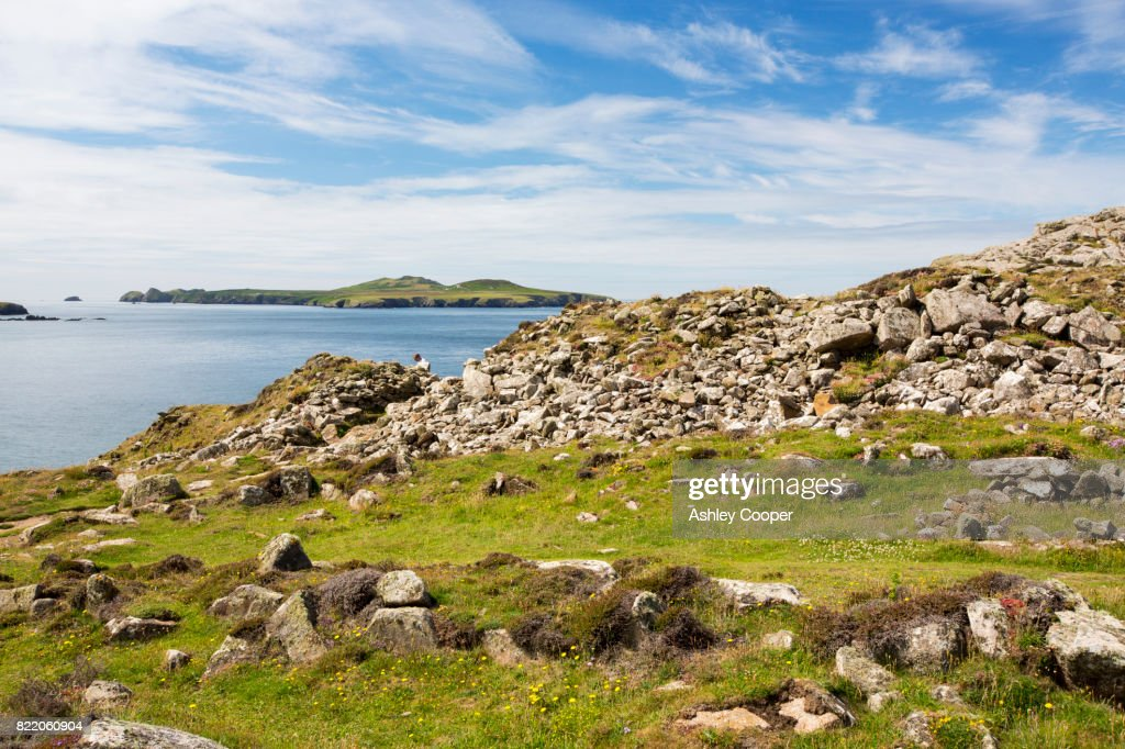 A hill fort at St Davids Head, Pembrokeshire, Wales, UK, looking towards Ramsey Island. : Stock Photo