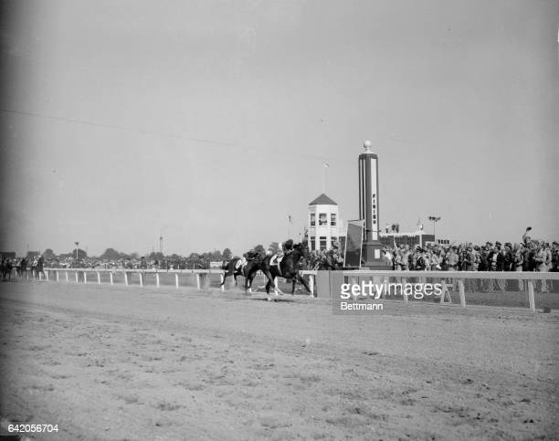 Hill Gail in the great tradition of Calumet Farm nearly at the finish line of a thrilling victory in the 78th running of the Kentucky Derby at...