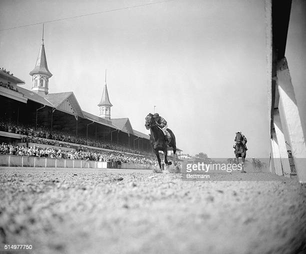 Hill Gail, in the great tradition of the Calumet Farm, crosses the finish line for a thrilling victory in the 78th running of the Kentucky Derby,...