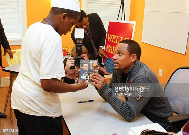 Hill Harper signs copies of his books after a discussion about empowerment financial literacy at The Fishing School on March 15 2010 in Washington DC