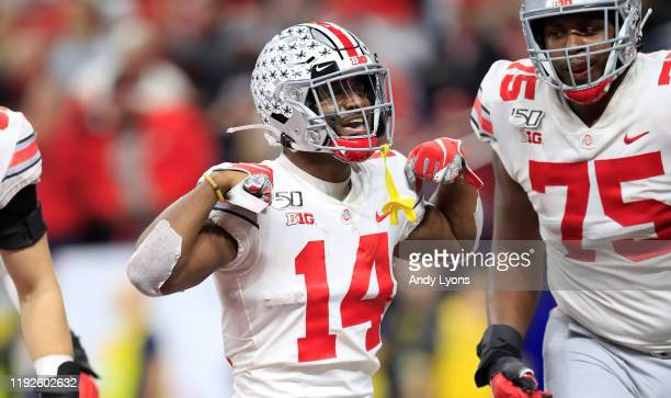 J Hill Jr #14 of the Ohio State Buckeyes celebrates after catching a touchdown pass during the BIG Ten Football Championship Game against the...