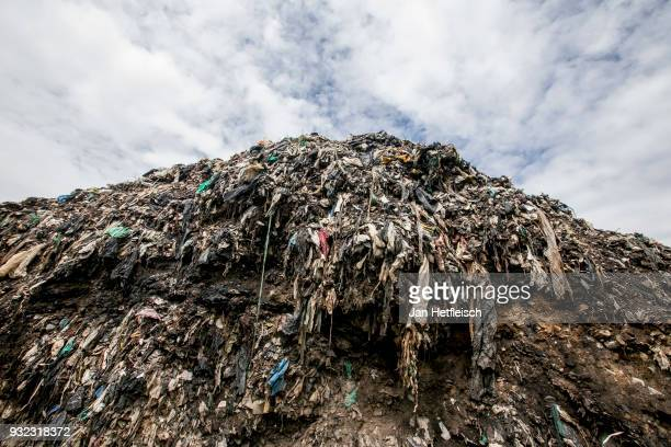 A hill of rubbish is seen on the Dandora rubbish dump on March 14 2018 in Nairobi Kenya The Dandora landfield is located 8 Kilometer east of the city...