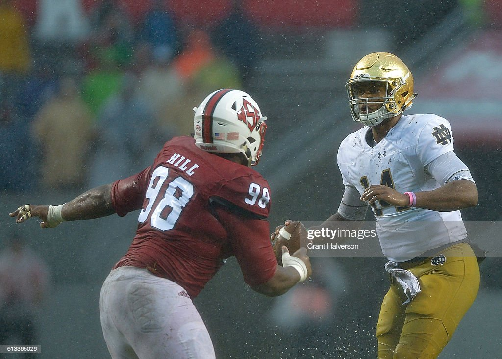 B.J. Hill #98 of the North Carolina State Wolfpack pressures DeShone Kizer #14 of the Notre Dame Fighting Irish during the game at Carter Finley Stadium on October 8, 2016 in Raleigh, North Carolina.