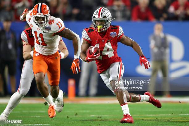 Hill of the Ohio State Buckeyes carries the ball against Isaiah Simmons of the Clemson Tigers in the first half during the College Football Playoff...