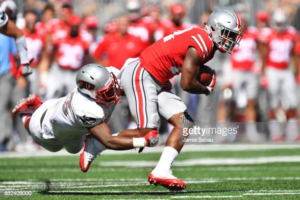 J Hill of the Ohio State Buckeyes is brought down after a pass reception by Farrell Hester II of the UNLV Rebels in the first quarter at Ohio Stadium...