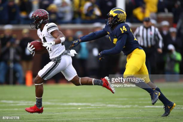 J Hill of the Ohio State Buckeyes is chased down by Josh Metellus of the Michigan Wolverines in the second half on November 25 2017 at Michigan...