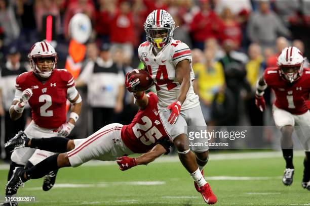 Hill of the Ohio State Buckeyes runs the ball in for touchdown in the Big Ten Championship game against the Wisconsin Badgers during the third...