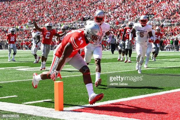 J Hill of the Ohio State Buckeyes scores on an 11yard touchdown pass reception in the second quarter against the UNLV Rebels at Ohio Stadium on...